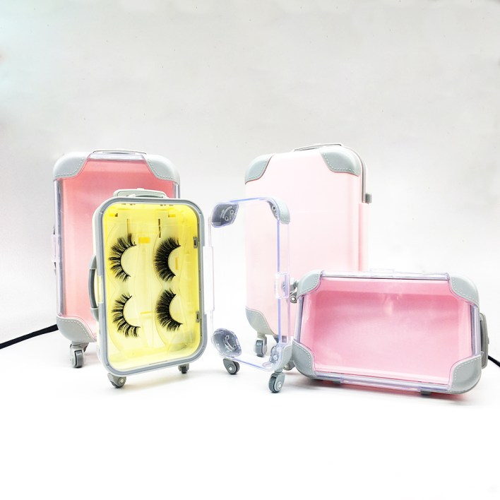 four pink and yellow Luggage type eyelash box