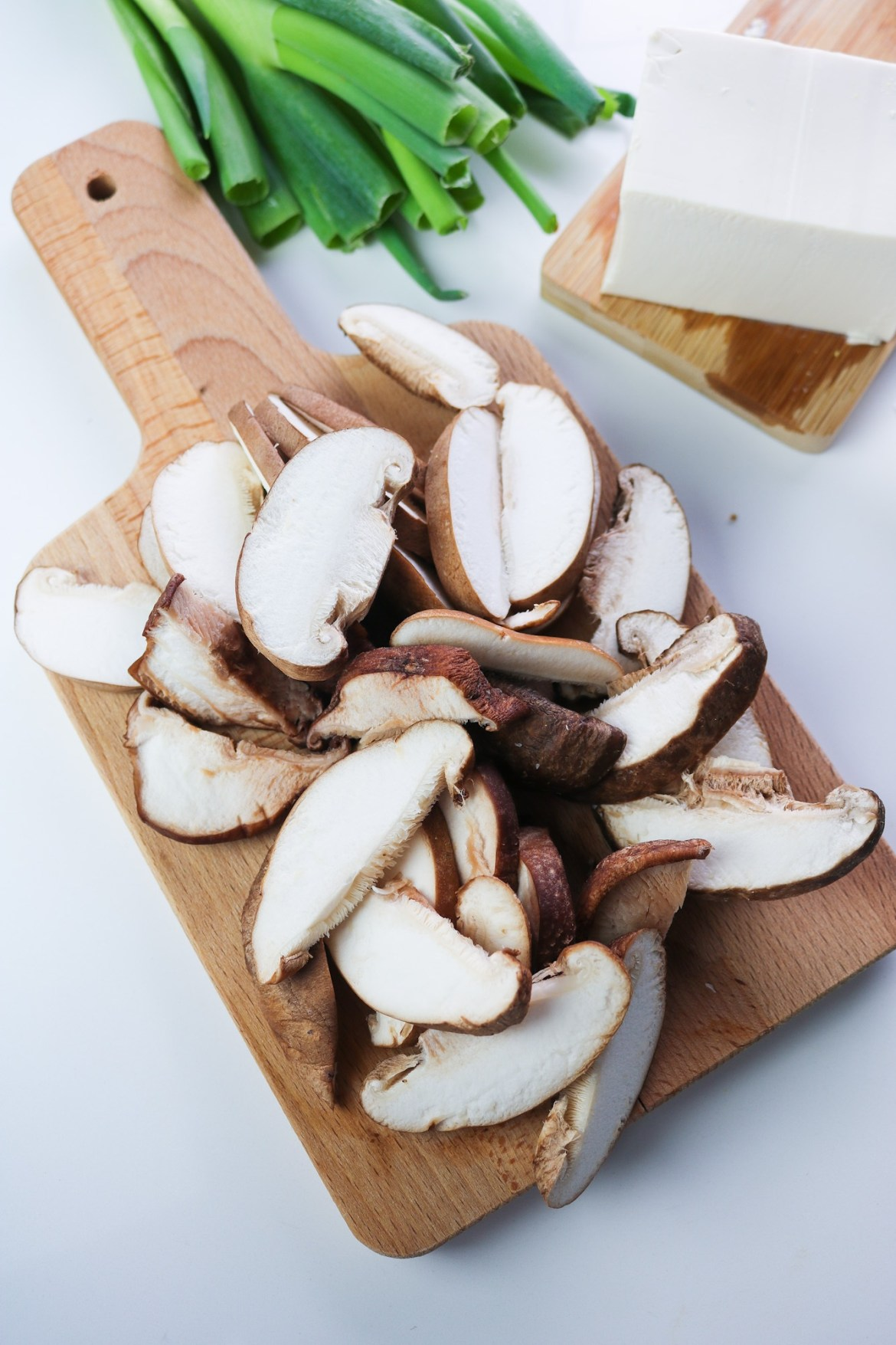 chopped shiitake mushrooms on a wooden board