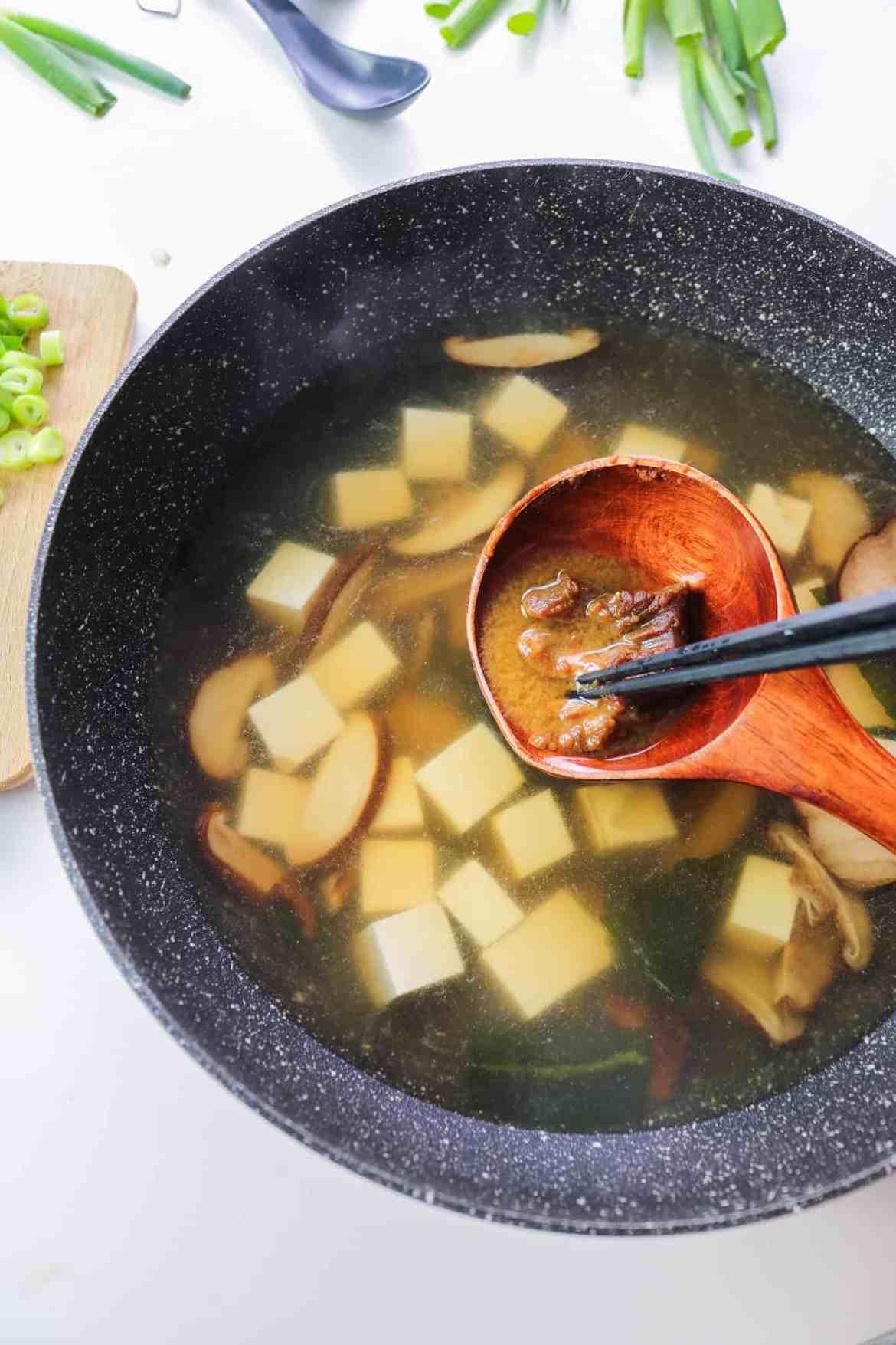 dissolving white miso paste in dashi broth