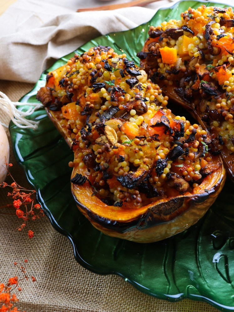 detail of one half of roasted buttenut squash filled with giant couscous and beans