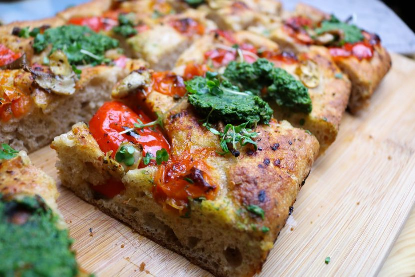Focaccia with fresh mushrooms, spinach&cashew nuts pesto, tomatoes and watercress.