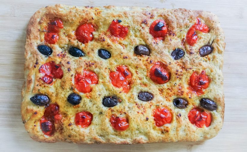 Classic Focaccia Barese on board ready to serve