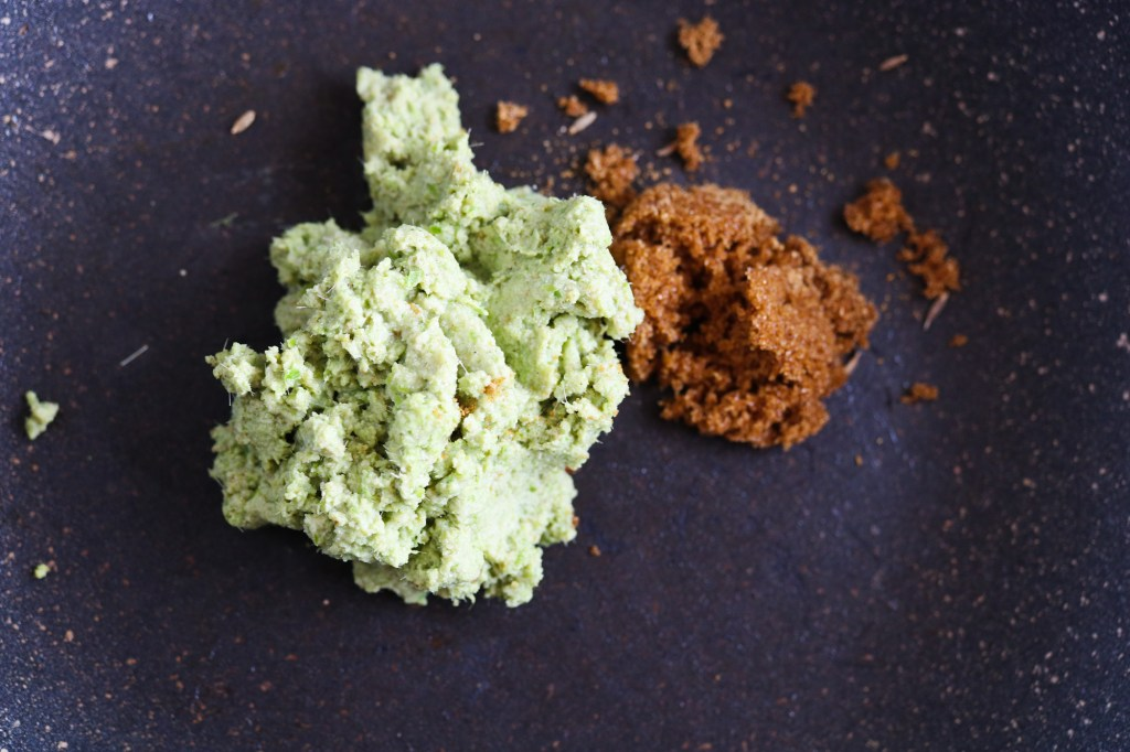 toasting spices and curry paste for vegan Thai Green Curry and rice noodles