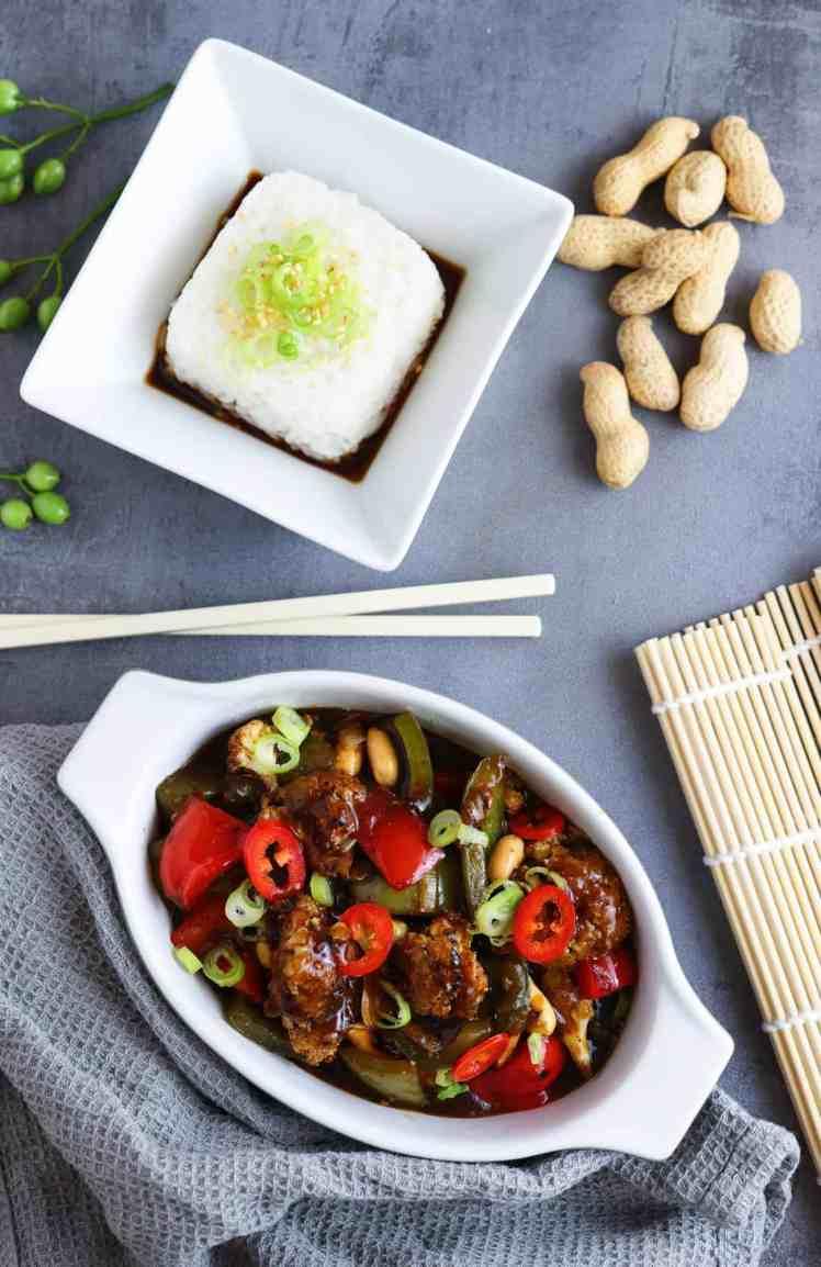 vegan and vegetarian Kung Pao Cauliflower with jasmine rice ready to eat with chopsticks