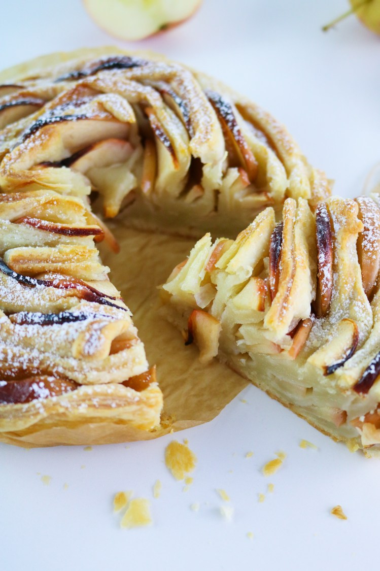 flaky apple tart close up to show layers of pastry and apple slices