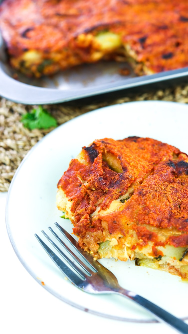 vegan courgette parmigiana slice with fork close up
