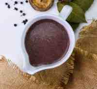 red wine, onion and shiitake mushrooms gravy in a white ceramic pot