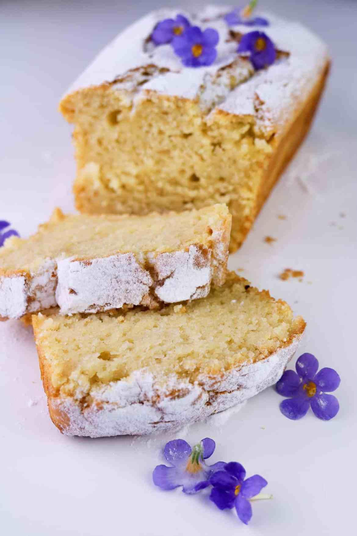This easy vegan lemon pound cake is soft, silky, light, fluffy and aromatic, with an irresistible lemony aftertaste. #vegan #poundcake #plantbased #eggless #dairyfree #lemon #sweet #dessert #madeira #sugar #baking #veganbake #vegetarian #eggfree