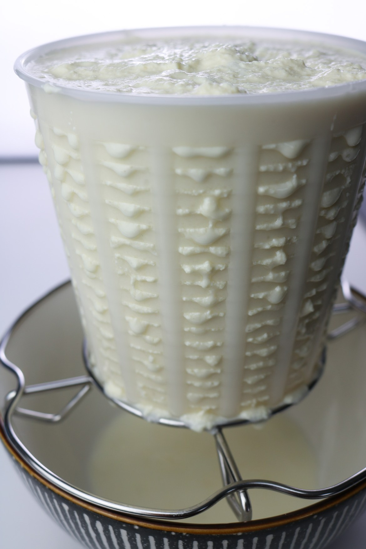 draining dairy free ricotta in a cheese basket