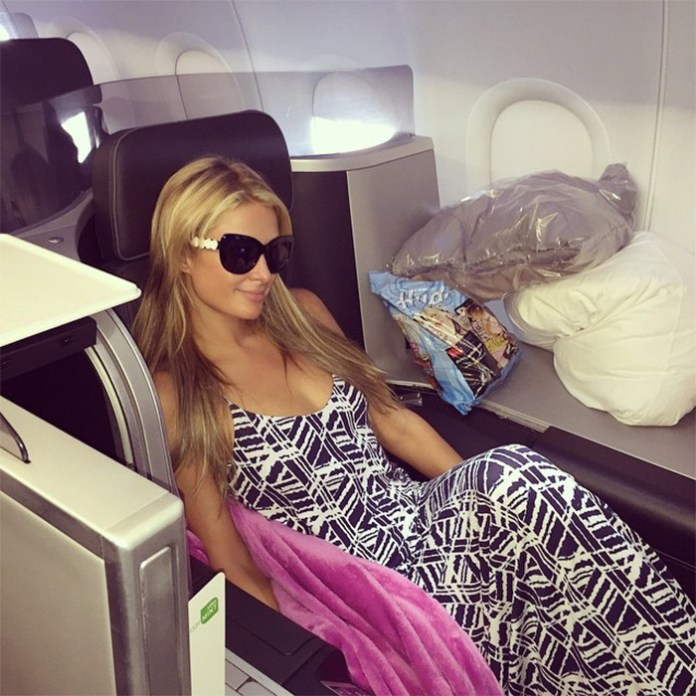 Paris Hilton on an airplane heading to NYC from LA