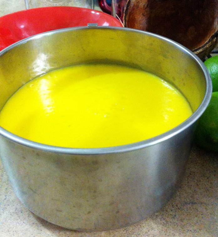 mango coconut ice cream mixture in ice cream bowl