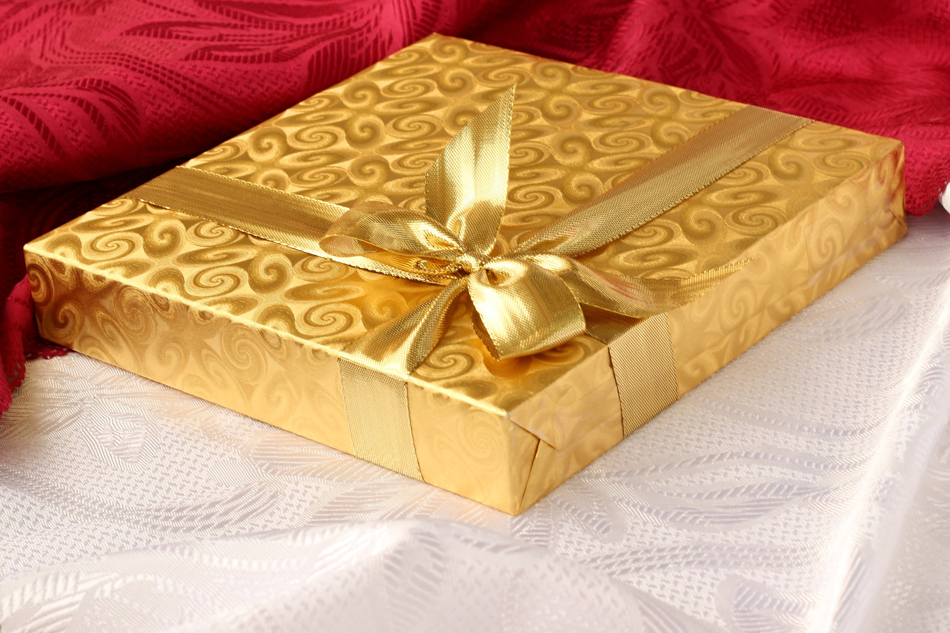 happy holidays 2015 picture of gift wrapped in gold wrapping paper