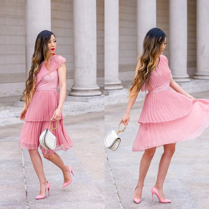 Sasa Zoe from the blog shallwesasa wearing a pink pleated dress with pink pumps