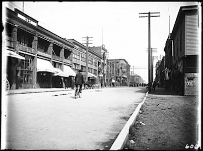 ReplaceBikewithCar - 500 Block of Carrall Street, Vancouver, in 1906: The streets still belonged to cyclists, horses and pedestrians – but cars were lurking on the horizon, poised to take over (Vancouver Public Library: Special Collections Historical Photographs)
