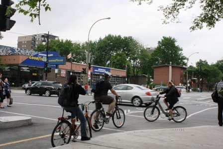 Cycling in Montreal. Montréal cyclists on two Bixi's (and a regular bike) on separated bike lanes
