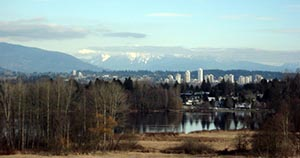Deer Lake Park Trails offer sweeping views of the lake and mountains. Deer Lake Park Bike Trails in Burnaby, BC, Canada