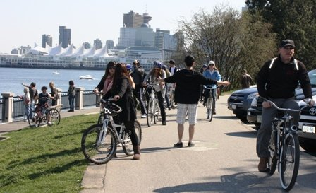 It is not wise to stand in the middle of the Stanley Park Seawall Bike trail waving your arms