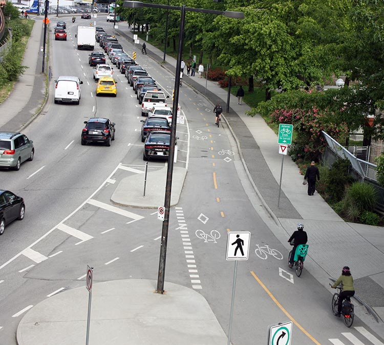 The Amazing Evolution of Vancouver Cycling Infrastructure. There have been awesome improvements to cycling safety in Vancouver. Sometimes it seems like everywhere I look, awesome separated bike lanes are springing up. Here's a view of some Vancouver separated bike lanes, looking down from the Georgia Viaduct. The Amazing Evolution of Vancouver Cycling infrastructure