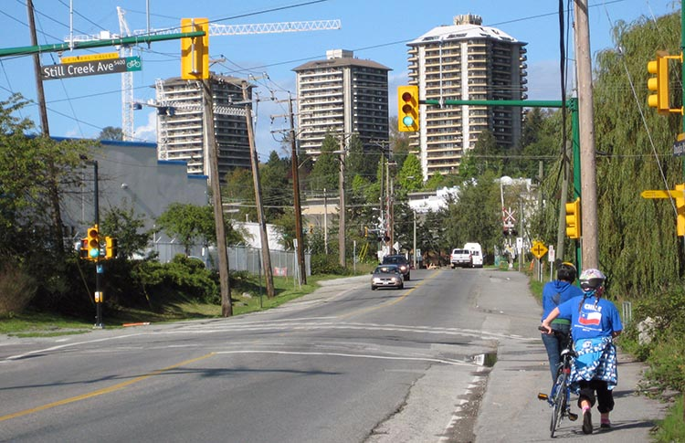 """People on bikes should not be relegated to the perimeters of transportation routes. Here, two of my kids push their bikes along a narrow, rutted sidewalk - sadly, this is a part of Metro Vancouver's """"Central Valley Greenway"""" ..."""