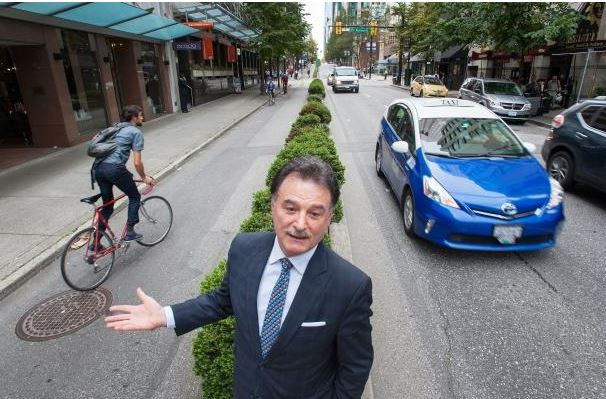 The photo of the photo of Mike Brascia published by the Vancouver Sun (below) was taken at such an angle as to NOT show the parking garage right next door to his shop. And across from his shop. And underneath his shop ...