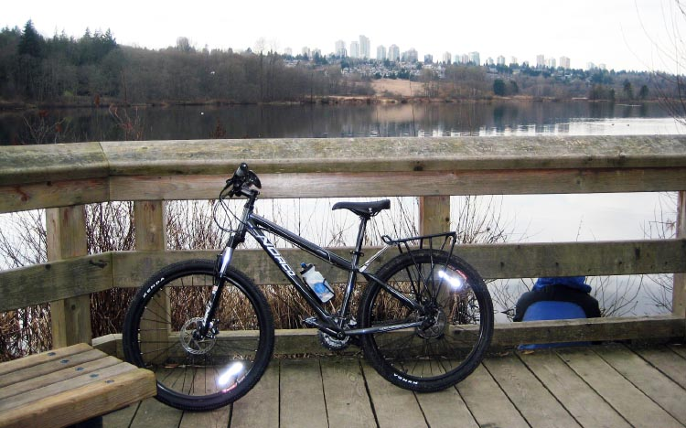 Cycling trails in Deer Lake Park offer sweeping views over to the heights of Metrotown. Deer Lake Park Bike Trails in Burnaby, BC, Canada