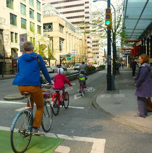 Families can now cycle on Dunsmuir Street, thanks to the relative safety provided by separate bike lanes