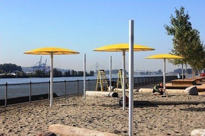 "New West Pier Park at the end of the Central Valley Greenway even has a ""beach"" with beach sand, umbrellas and hammocks!"