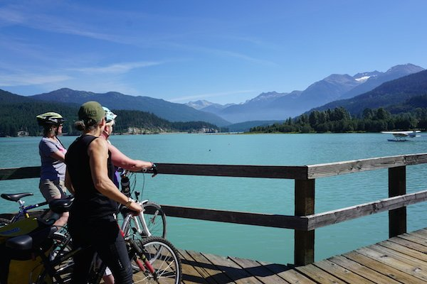 Halfway across the boardwalk bridge at Green Lake is a lookout point where you can get out of the way of other cyclists and enjoy the scenery . Whistler Valley Trail – Whistler Village to Green Lake