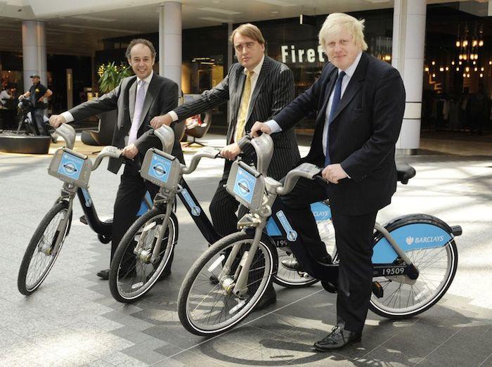 Look Ma, no helmets! Mayor Boris Johnson (front) and friends show off London's successful bike share bikes, the Barclays Bikes (aka Boris Bikes). Vancouver Bike Share