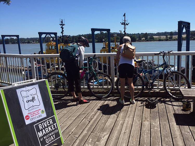 You can lock your bikes to the railings that run the whole length of the New Westminster Quay. New Westminster cycling