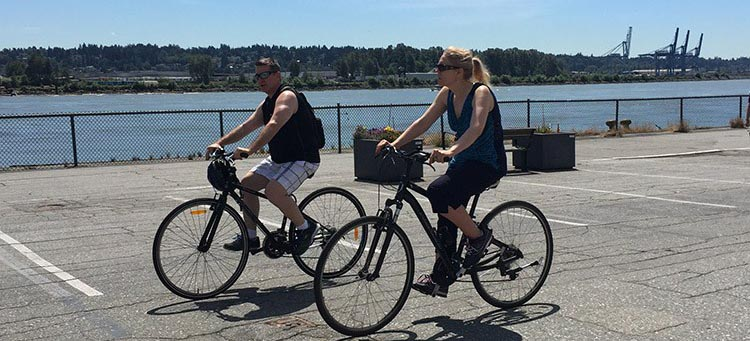 Feel the river breeze in your hair as you cycle along in safety at the New Westminster Quay. New Westminster cycling