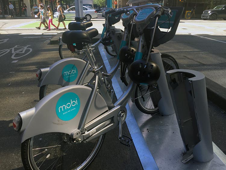 Vancouver's Mobi Bike Share bikes are supplied with helmets attached.