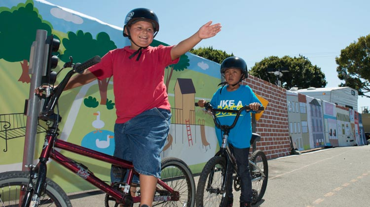 Kids who bike to school in North America need to learn basic cycling and safety skills. How to Help your Kids Bike to School