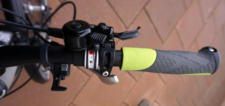 Right hand controls on the handlebar of the Haibike Xduro Trekking Pro. The no. 9 is highlighted in red on the gear controller, showing that I have selected gear no. 9 (the hardest rear gear). The little silver lever below the grip is the rapid-fire gear lever. How to Change Gears on a Bike