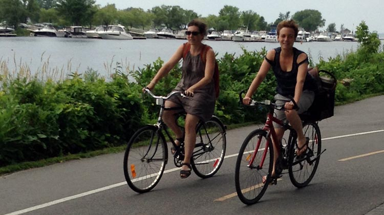 Cyclists enjoy the wind in their hair on the Lachine Canal Bike Path