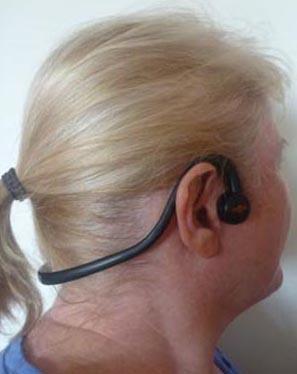 Maggie models the Aftershokz Sportz headphones