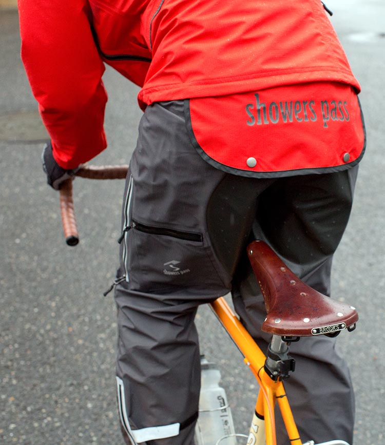Cyclists need a dropped tail on their cycling jackets, to keep their rear ends dry. That's the most important difference between cycling jackets and other waterproof jackets. This is a Showers Pass Refuge cycling jacket with a dropped tail that can be clipped up when not in use