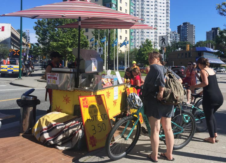 Just after you exit Stanley Park, you can choose to stop and buy a pretty good hot dog off a cart on the side of the Seaside Bike Route. This vendor boasts an all-beef Alberta hot dog!
