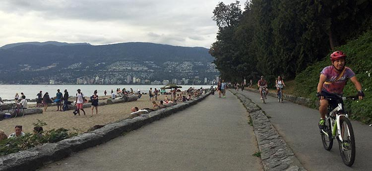 Cycling past Third Beach on the Stanley Park Seawall