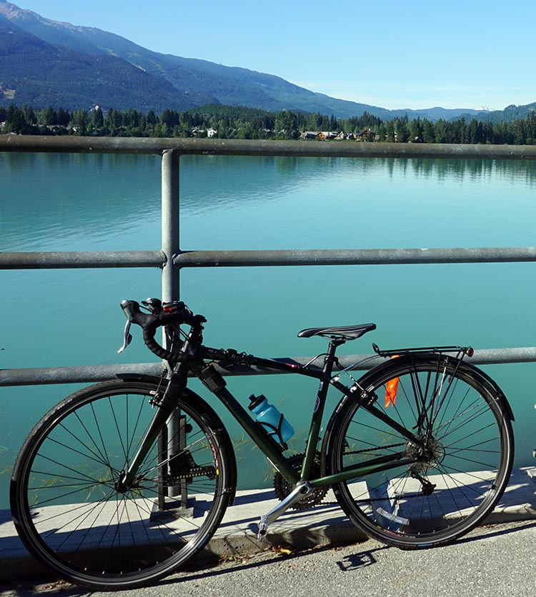 The reason I like the Specialized TriCross as a commuter bike is that (like all Specialized bikes with carbon forks) it soaks up the bumps really well. On the one hand, this makes it a great bike for the trails, and I had a wonderful time in Whistler with it. Here it is, posing beside Green Lake in Whistler.