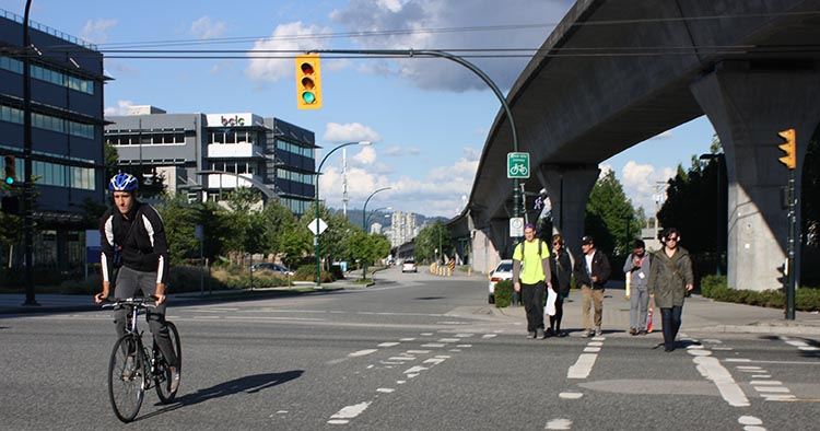 The cross street at Renfrew Skytrain can be a gong street at rush hours. Try to avoid crossing here at rush hour. It takes good cycling skills to avoid hitting pedestrians or being hit by turning cars and trucks.