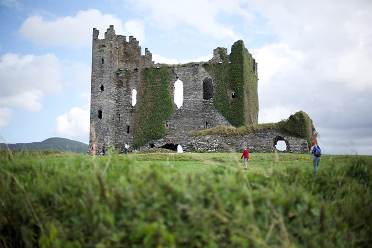 Cycling in Ireland gives you the opportunity to see castle ruins from your saddle