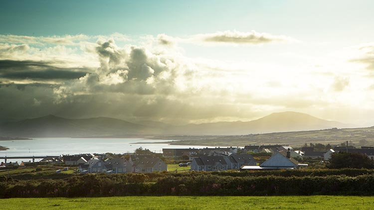 When cycling in Ireland, expect to see almost eerily beautiful villages under awesome skies