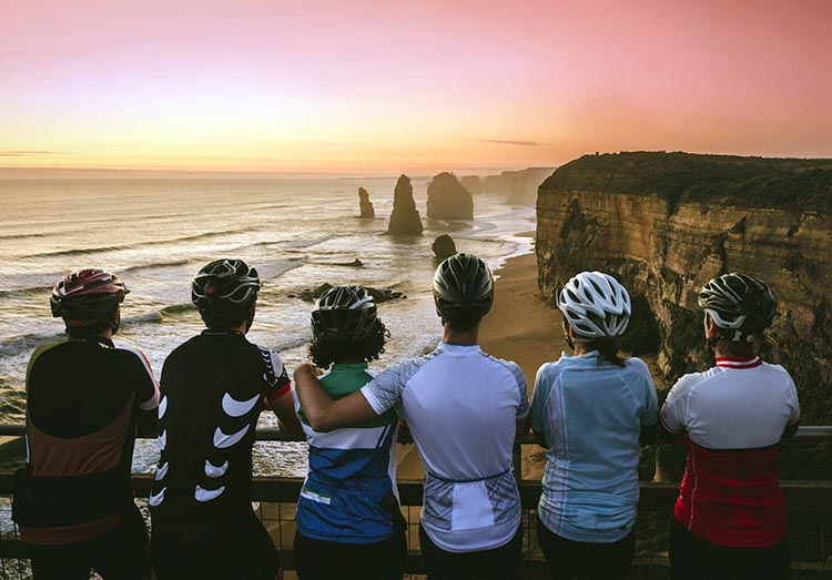 RACV Great Victorian Bike Ride/Vacation offers iconic views like Sunset over the 12 Apostles on Great Ocean Road.