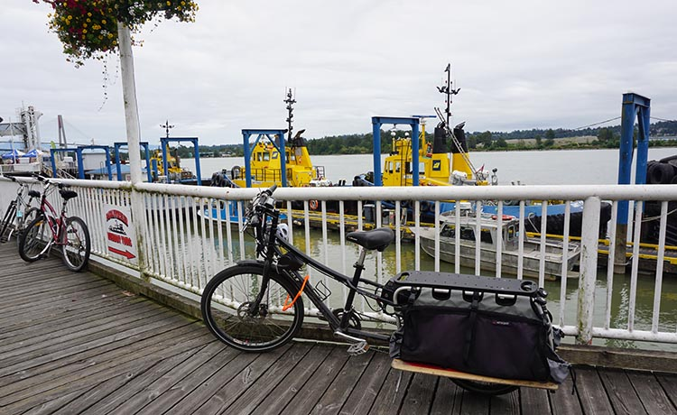 Sometimes you will see interesting bikes tied to the safety fencing on New Westminster Quay - such as this electric bike. New Westminster cycling