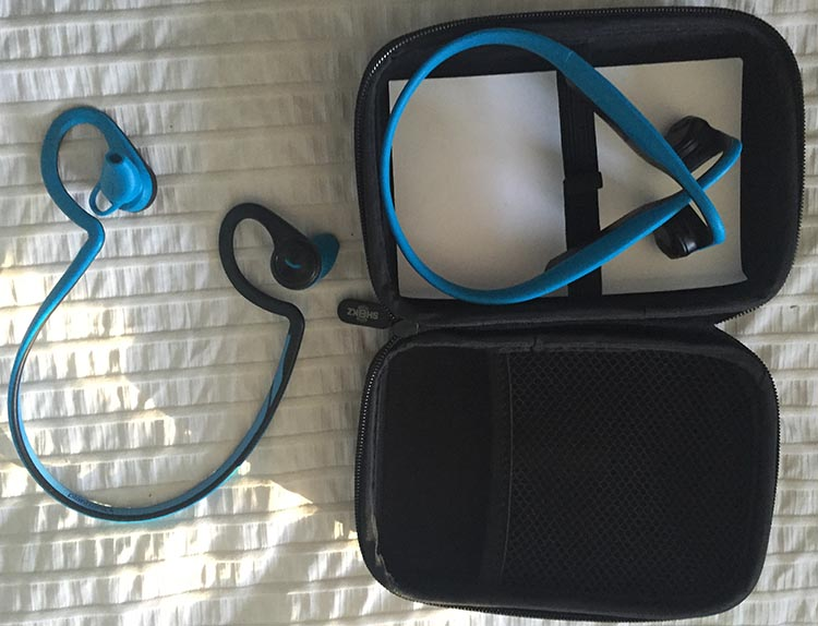 The Aftershokz come with a neat little zippered storage case. It is hard sided, and I use it to carry all my headphones around. I switch from Aftershokz (on the right) to Plantronics (on the left) after I finish my bike ride to work. And yes, my secret it out - I like blue!