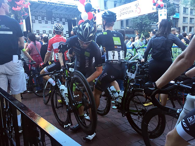Cyclist getting his bike ready for the Gastown Grand Prix. BC Superweek 2017