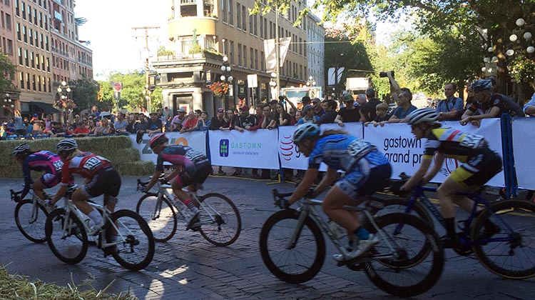 Several women take the most difficult corner in Global Relay's Gastown Grand Prix criterium. BC Superweek 2017