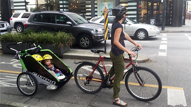 Here's a mother showing how to safely transport kids on bikes - in one of the wonderful separate bike lanes in Vancouver. This is the intersection of Hornby Street and Dunsmuir Street, at the heart of Vancouver's separate bike lane network