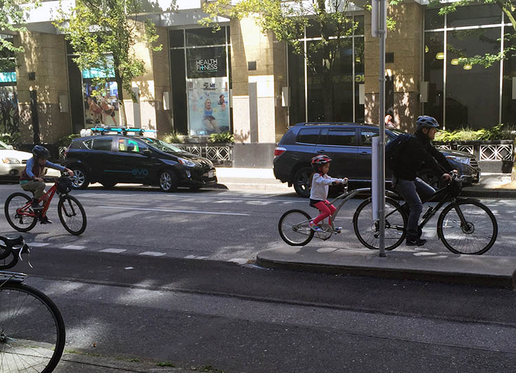 As this family came towards me on their rented bikes, they suddenly veered out of the bike lane and into the two lanes of car traffic on Hornby. Notice how awkwardly the little guy at the back is cycling. He was NOT in a safe situation here. Cars are Important - Little Kids, Not so Much